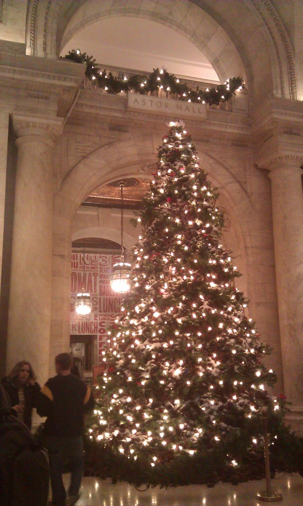 My photo of the Christmas tree standing in the entrance of the NYC Library.
