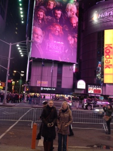 The girls posing in fron of the gigantic Hobbit poster at Time Square.