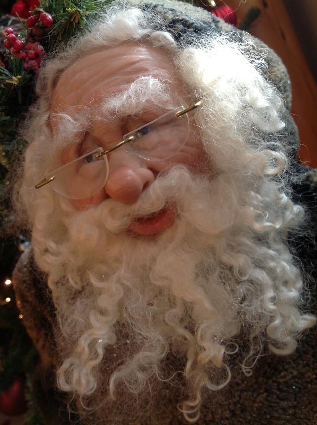 Big Boss gave me this Santa made by a Kansas artist.  I love this Santa's eyes!!! Dreamy! L)
