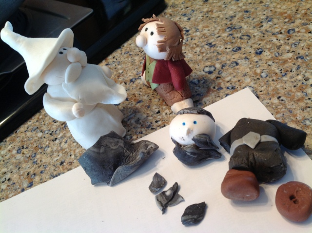 Gumpaste Gandalf and Gumpaste Bilbo discus what to pack for their upcoming trip.