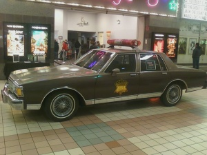 The Hodgeman County Sheriff's car, created for Rabid Love the movie, was parked inside the mal in front of the movie theater for the Sunday night screening. Photo courtesy of Candace Ruff.