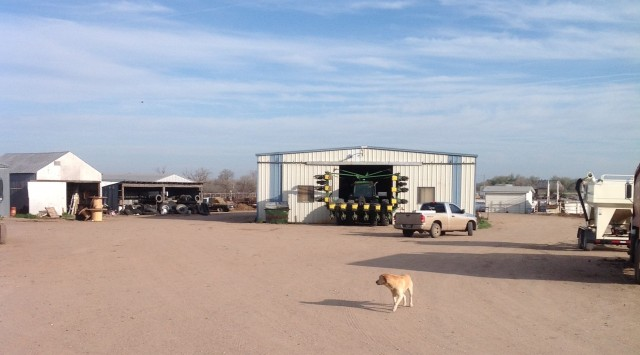 Mo (Moses) the yellow lab, oversees the tractor upkeep as the guys are ready to PLANT!!!