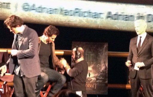 Bloom and Armitage getting the mics on.