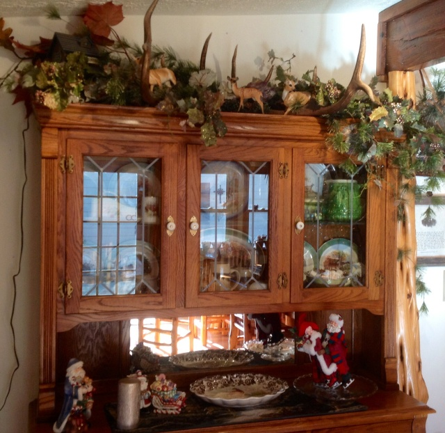 Big Boss's elk rack has made its home on top of the hutch for several years...yearound.