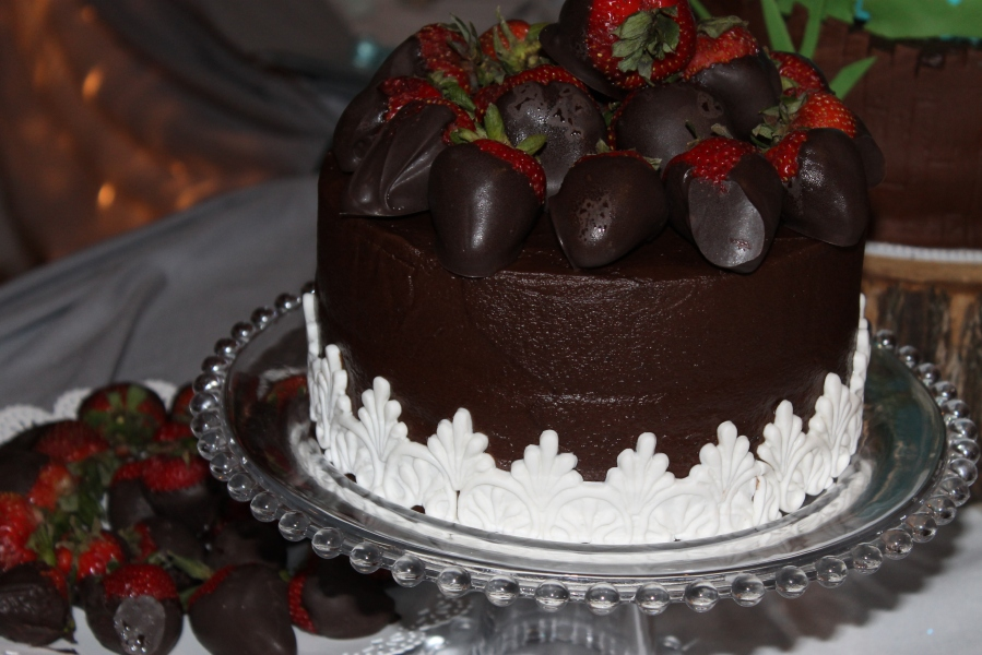 Chcolate dipped strawberries on chocolate cake