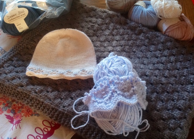 knitted baby hat, blanket