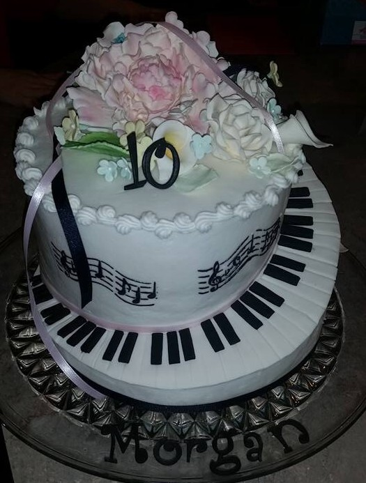 carved musical staff piano keyboard cake