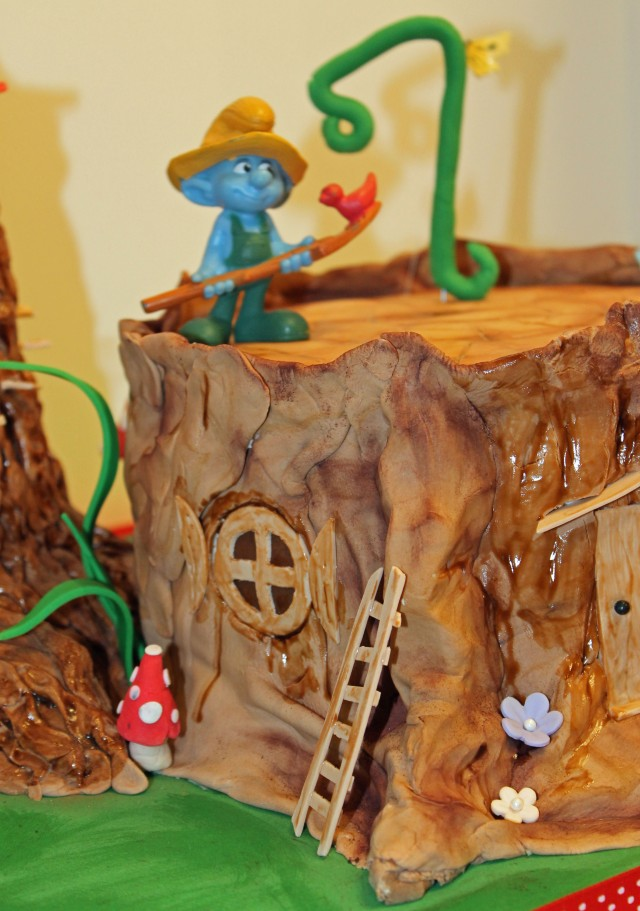 Smurf tree stump cake
