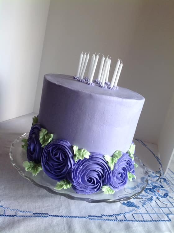 purple birthday cake, rosettes